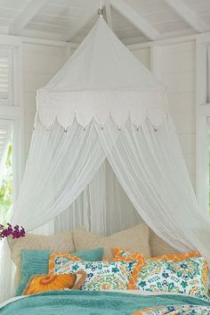 Look no further than our Jimbaran Bay Canopy to create a tropical resort vibe within your very own bedroom! Crafted in a small Balinese village, this canopy features a scalloped overlay, accented with dangling gold coins.