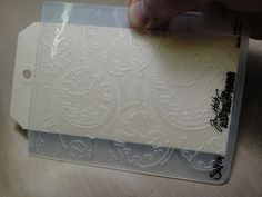 Great tip on cutting slits in embossing folders - good for tags and long strips