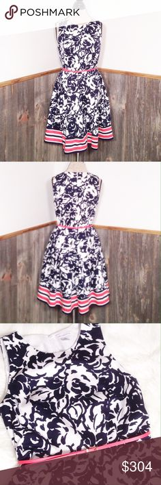 """Liz Claiborne fit and flare dress Great condition no flaws or stains, fully lined.  Hidden back zipper, and box pleats.  Navy blue flowers with a salmon colored belt and contrasting stripes.  Underarm to underarm is approx 19"""", waist is approx 16.75"""", length is approx 37"""".  97% cotton 3% spandex.  100% polyester lining.  Smoke and pet free home. Liz Claiborne Dresses"""
