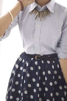 Adorable outfit. Navy blue skirt with white polka dots. Light blue button up. Don't like the necklace.