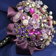 I'm toying with this idea...brooches instead of flowers