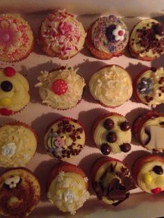 Vanilla cupcakes, confectioners's cream and chocolate decoration