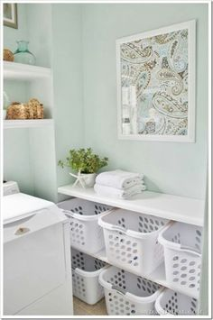 I love the horizontal laundry basket shelf. There are some great examples for inspiration in this post.