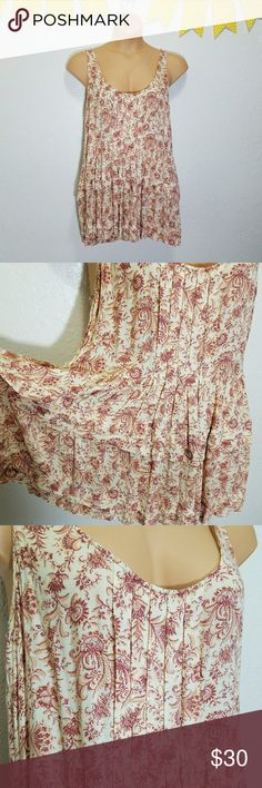 """Intimately Free People Layered Peplum Top F16 -Excellent used condition- no stains, rips, or tears -Super soft  -Slightly transparent -Gorgeous pleated details Please use measurements for best fit, all measurements are taken laying flat: -Bust 19"""" -Length shoulder to hem 32"""" -100% Rayon -Antique red and muted orange over an antique cream (colors' appearance may vary on screen)  Questions? Just ask! Bundle to save!  Offers welcome  Happy Poshing! Free People Tops Tank Tops"""
