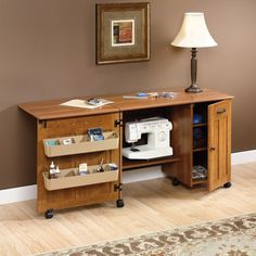 Sewing / Craft Center - Folding Table Furnish your craft room with the Sauder Sewing and Craft Table. This handsome piece of furniture features a drop leaf that