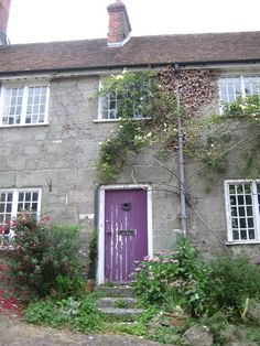 tattered purple door still lookin' good by Rosiefay