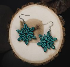 """Length: 1.6 Centimeters; Drop length: 2.4 Centimeters; Width: 1.6 Centimeters These beautifully hand-crafted flower paper quilling earrings are made from 1/8"""" thick turquoise & black paper strips. These make amazing gifts for the 1st anniversary and also for birthday Paper Quilling Earrings, Quilled Paper Art, Paper Quilling Designs, Quilling Paper Craft, Quilling Ideas, Quilling Patterns, Polymer Clay Earrings, Disney Earrings, Handmade Rakhi"""