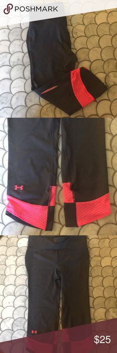 Under Armour Leggings Under Armour leggings supporting Breast Cancer Awareness (see photos).  Worn only a few times - grey with pink mesh details. Small zipper pocket at lower back. Size small.   More info can be provided on request! Under Armour Pants Leggings