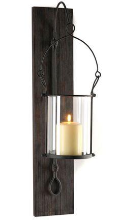 "WANT IT :: Metal Hanging Lantern Sconce :: $34.99, Now $29.99 | kirklands.com :: [5""w, 8.5""d, 25""h] Metal w/ dark bronze finish & wood composite. Comes w/ glass hurricane & is wall mount ready. | #kirklands #sconce"