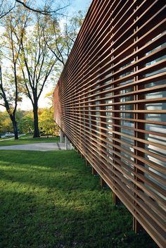 Why not this instead of burglar bars? Modern facade with slatted Cumaru wood screen, Dan Rockhill, Lawrence, Kansas