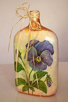 purple pansy on Decoupage Bottle tied with twine. Wine Bottle Art, Painted Wine Bottles, Diy Bottle, Wine Bottle Crafts, Bottles And Jars, Glass Jars, Decorated Bottles, Garrafa Diy, Altered Bottles