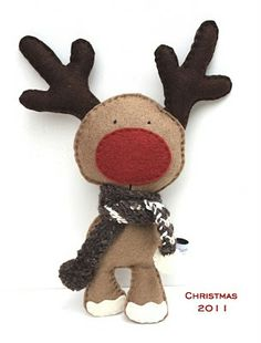 "Felt Reindeer - okay - this is in a different language, so I don't know if I can find a pattern, but I think I can ""borrow"" the design!  It tickles me!!"