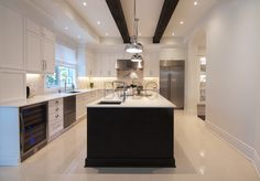 Classic contemporary kitchen style with maple cabinet painted in white lacquer.