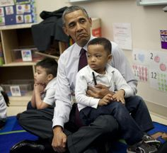 President Obama and young Marcus Wesby during his visit to Powell Elementary School. He must be a fun dad!