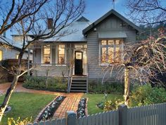 Corrugated iron edwardian house exterior with picket fence & landscaped garden Exterior Color Schemes, Exterior House Colors, Colour Schemes, Exterior Paint, Brick Facade, Brick Path, Brick Walkway, House Exteriors, Facade House