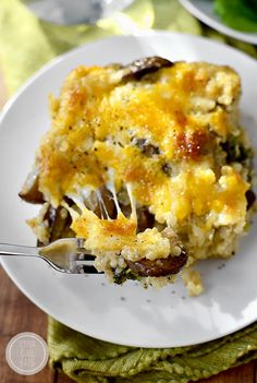 Cheesy Mushroom and Broccoli Quinoa Casserole - A hearty meatless casserole that will get two thumbs up from your family!