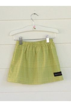 "A-line Skirt, Green Check, this fun little skirt is easy to wear and pair beautifully with our Coral Teapots Flutter Sleeve  Dress if you want to do a ""sister act"" combo. www.fabulousgirlboutique.com"