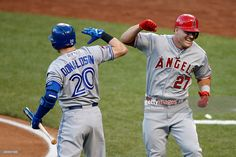American League All-Star Mike Trout #27 of the Los Angeles Angels of Anaheim celebrates with teammate American League All-Star Josh Donaldson #20 of the Toronto Blue Jays after hitting a lead off home run in the first inning against National League All-Star Zack Greinke #21 of the Los Angeles Dodgers during the 86th MLB All-Star Game at the Great American Ball Park on July 14, 2015 in Cincinnati, Ohio.