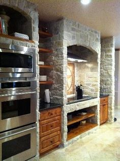 Rustic Texas stone kitchen wall remodel with open rustic wood shelving