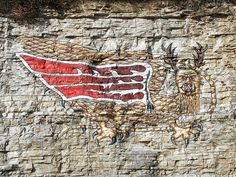 The Piasa Bird,  Alton, Illinois.  The original petroglyph was blasted off the cliff just west of Alton, when the River Road was widened to 4 lanes back in the late fifties or early sixties, I think.