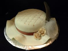 Kentucky Derby hat - Kentucky Derby Hat cake made for a friend who was heading to a Derby party. Classic vanilla cake covered in fondant. Roses are made of fondant.