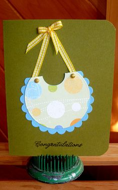 Create a bib from a scalloped circle punch and a circle punch; simple and cute. the indent in the bib from another smaller circle punch.