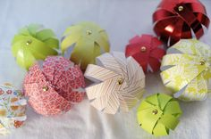 Paper Bulbs ~ Ornaments ... I can think of so many papers to make these with.  Maybe even photos.