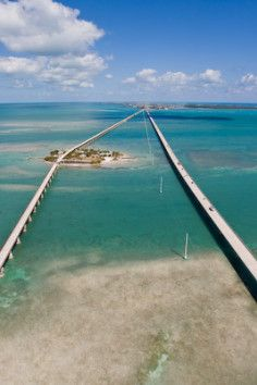 """A masterpiece of engineering.""""The Seven Mile Bridge is a famous bridge in the Florida Keys, in Monroe County, Florida, United States. It connects Knight's Key (part of the city of Marathon, Florida) in the Middle Keys to Little Duck Key in the Lower Keys. Among the longest bridges in existence when it was built, it is one of the many bridges on US 1 in the Keys, where the road is called the Overseas Highway."""
