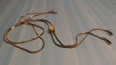 The+lariat+style+is+quite+retro+feeling.+The+slide+is+gold+with+a+mother+of+pearl+inlay.+The+length+is+approximately+16+inches.+It+is+NEW,+although+vintage,+being+created+in+1978+by+Artistry+of+Amway.+The+clasp+bears+the+Artistry+logo.+