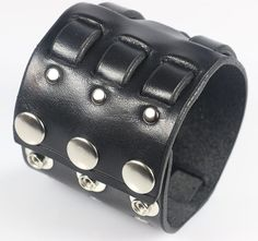 "The Triple Weave cuff is a signature design at Leatherpunk. Three 1/2"" straps loop through the 2 3/8"" wide cuff several times, The straps then taper off and are secured via high quality chrome plated"