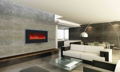 Warm up any space with the sleek and sophisticated Amantii WM-BI-34-4423, featuring temperature maintenance controls and the ability to add a back lit glow in your choice of 13 colors. This stylish electric fireplace will add a touch of elegance to a space by day and a splash of colour by night.  This unit can be wall mounted or built-in to the wall for a more custom look and finish. Comes standard with three colors of decorative media and an LED ember log set in the box.