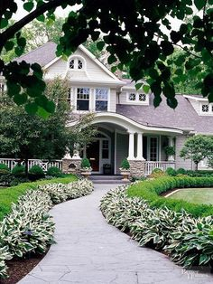 Love everything about this - winding paved walkway, borders, porch, gabled house.