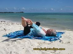 """A modification of the Happy Baby Pose, known as Stirrup Pose in Yin yoga, extend your left leg, while hanging onto your left big toe with you """"peace fingers."""" This pose is being done on beach in Playa del Carmen, Mexico. Happy Baby Pose, Yin Yoga Poses, Peace Fingers, Hip Openers, Central Nervous System, Get In Shape, Big Toe, Beach Mat, Mexico"""