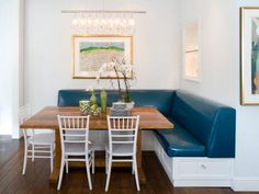 A blue L-shaped banquette bench takes center stage in this white contemporary dining room design. Bench Seating Kitchen Table, Corner Bench Seating, Storage Bench Seating, Kitchen Banquette, Booth Seating, Kitchen Benches, Seating Plans, Kitchen Dining, Banquet Seating