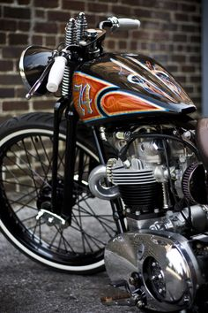 Beautiful custom bike with a springer front end and fantastic paint.
