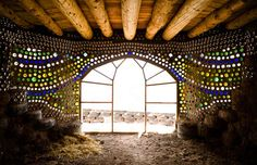 Earthship design - colored bottles embedded in the wall creating a great ambient light effect with an artistic flair