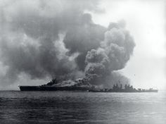 USS Bunker Hill burns after being hit by Kamikazes as the cruiser USS Pasadena closes in, May 11 1945.[2765x2069]