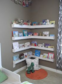 Bookcases from GUTTERS from Lowes ... What great idea. Will cave if little monkeys try to climb it, no sharp edges, no painting, and cheap!!