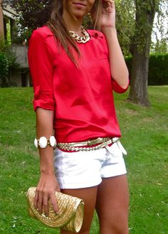 bright coral roll sleeve top, white shorts, gold chunky chain necklace, white stone bracelet, gold belt, gold clutch
