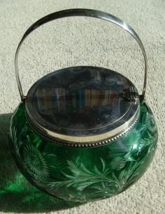 A Stevens and Williams Biscuit Barrel/Jar and cover. the green glass body intagio cut to clear, c.1890