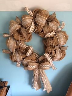 Beautiful bubble wreath, with 4 types of ribbons... natural and white chevron, lace layered burlap, natural khaki net and a khaki linen. The base