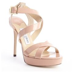 Vamp it up with this trendy platform sandals just in time for spring courtesy of the lovely Jimmy Choo! Shiny patent leather upper. Rounded open toe. Crisscros…