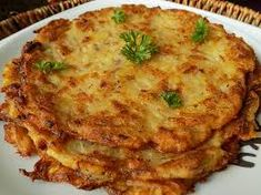 Bramborák or Czech Potato Pancakes Brambor?k or Czech Potato Pancakes Czech Recipes, Ethnic Recipes, Polish Potato Pancakes, Plum Dumplings, Bread Dumplings, Sweet And Sour Cabbage, Prague Food, Shredded Potatoes, Dumpling Recipe