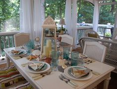 beach decor - If I ever own a lake condo, I would love to do this in the dining area!
