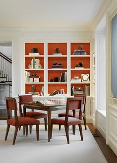 Northern California Residence Dining Room Dining Contemporary American by The Wiseman Group bright orange paint inside back of white book shelves Clad Home, Interior Design Books, Sliding Wardrobe Doors, Wood Architecture, Modern Architects, Transitional Living Rooms, Northern California, Home Remodeling, Libraries