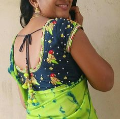 Want to check out the contrasting blouse colors to wear with green sarees? Here are 15 blouse colors that are trending this year. Blouse Back Neck Designs, Hand Work Blouse Design, Simple Blouse Designs, Silk Saree Blouse Designs, Bridal Blouse Designs, Blouse Designs Catalogue, Maggam Work Designs, Designer Blouse Patterns, Women's Fashion