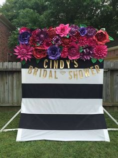 floral backdrop at a bridal shower party / http://www.himisspuff.com/black-and-white-sassy-stripes-wedding-ideas/6/