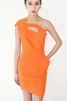 spectacular vintage 1980s THIERRY MUGLER neon orange asymmetrical dress w/cut-out. $785.00, via Etsy.
