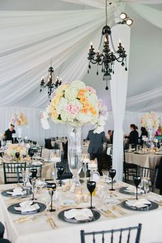 Adding strong black elements to your wedding can anchor really bright florals. It will also always bring a more traditional and classic look.  Love the black chandeliers in this wedding reception (versus white) and black wine glasses. -BE  www.EventDesignbyBE.com