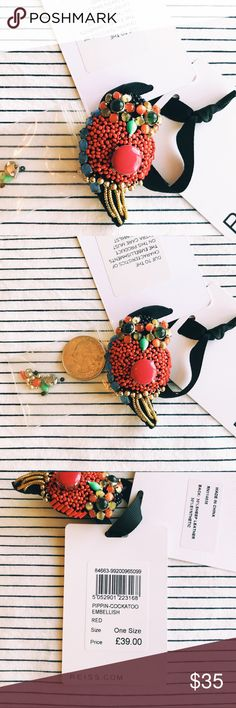 """NWT Reiss Bird Brooch Add some contemporary kitsch to your look with this colorful bird brooch/pin from REISS. NWT. Includes a bag of extra beads and embellishments. It measures approximately 2.5"""" in length. Main colors are orangey red, blue and gold. Reiss Jewelry Brooches"""